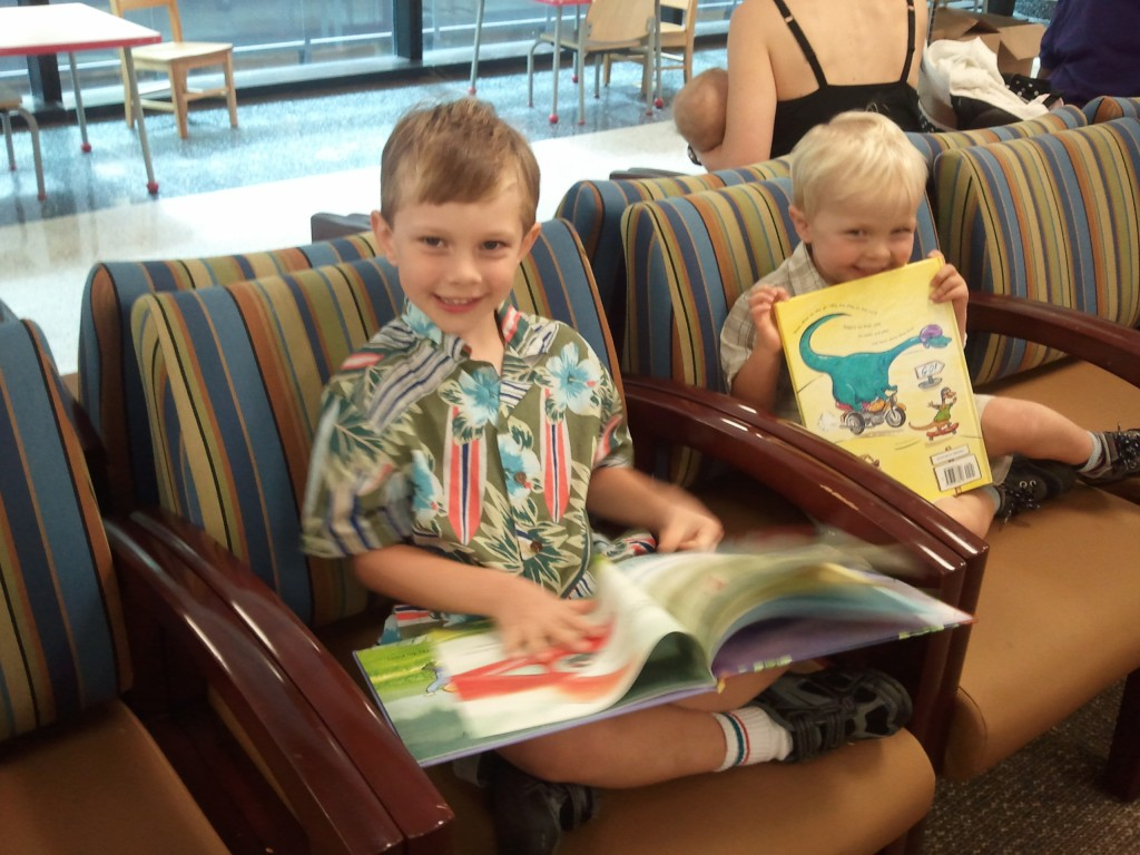 Children enjoying their new books at Walter Reed